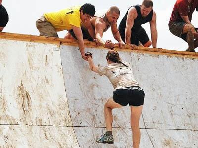 woman-climeb -man-reach-steep
