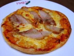 スペイン産赤豚の煮込みのピッツァ